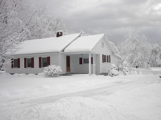 MIDDLEBURY, VT - A view of our first house after a storm. Winter 2004.